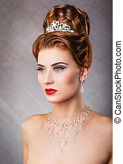 Queen - Portrait of beautiful woman with elegant hairstyle...
