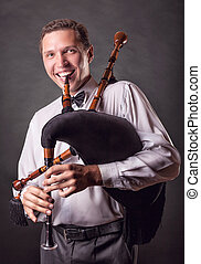 Spanish bagpipes - Smiling musician playing the Spanish...