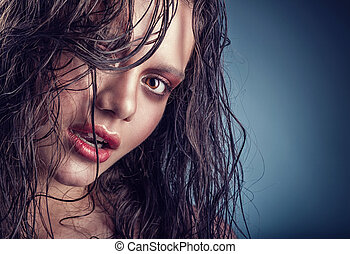 Wet hair - Beautiful young woman with a gentle makeup and...