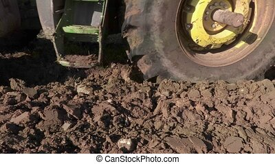 Tractor plowing field close up