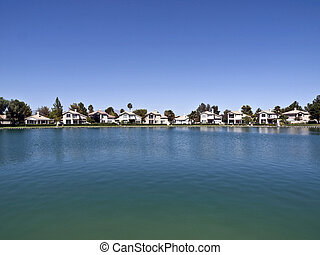Desert Lake Homes - Lake front homes with Palm Trees in a...