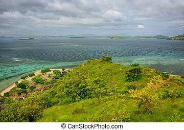 Coastline of Kanawa Island in Flores Sea, Nusa Tenggara,...