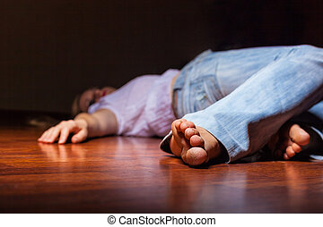 Victim - The dead woman's body. Focus on the foot