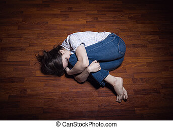 Loneliness - Lying on the floor of a lonely young woman in a...