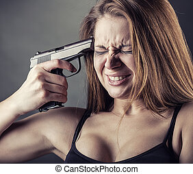 Suicide - Woman with pistol pointing on her head