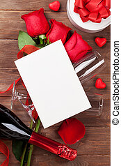 Red roses, champagne and greeting card - Red roses,...