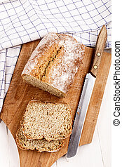 sliced irish soda bread on a wooden bpard - sliced irish...
