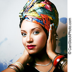 beauty bright african woman with creative make up, shawl on...