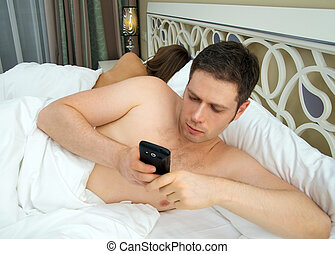 Man cheating while wife is sleeping.