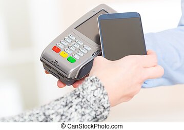 Paying contactless with smart phone - Making contactless...