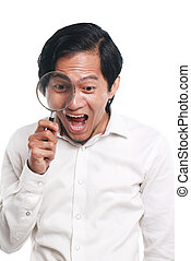 Happy Asian Man With Magnifying Glass - Photo image portrait...