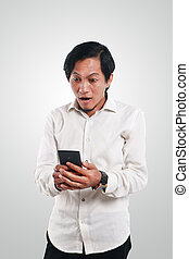 Shocked Asian Man With His Smart Phone - Photo image...