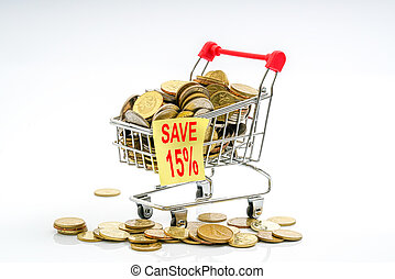 Trolley and coins. - Trolley and coins with sale concept.