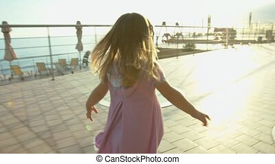 Little girl running to parents in the park
