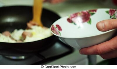 man puts the eggs in a bowl