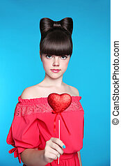 Smiling teen girl with bow hair style, brunette young model...