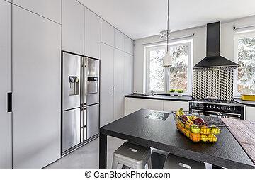 Modern kitchen with steel fridge - Modern and light kitchen...