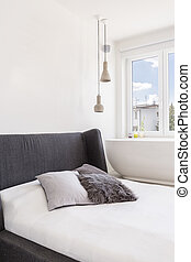 Fluffy pillow on the bed - Badroom with white walls and grey...