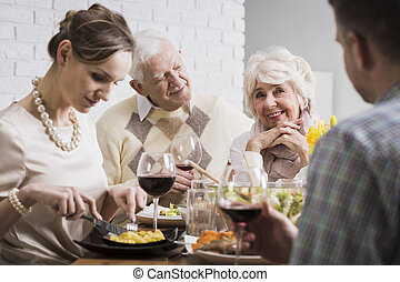 Family eating together at the table - Shot of a joyful...