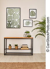 Monstera leaf wall decor, furniture made from wood and metal