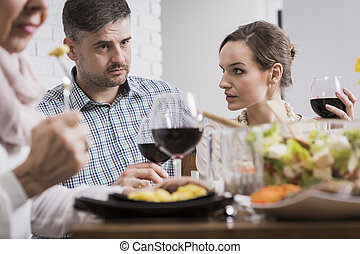 Couple arguing during family dinner - Young elegant couple...