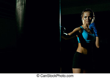 Woman Boxer With Punch Bag In Action