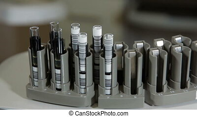 Blood test tubes in a support for analysis and diagnostics...