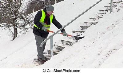 Man shoveling snow on stairs
