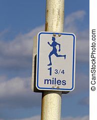 Mileage Sign For Runners - A sign displaying the symbol of a...