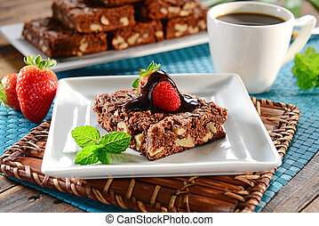 Chocolate Brownie peace with strawberry on top in square...