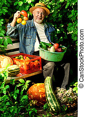 good harvest - Happy senior man with great harvest in the...