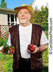 cultivating vegetables - Portrait of a smiling senior man...