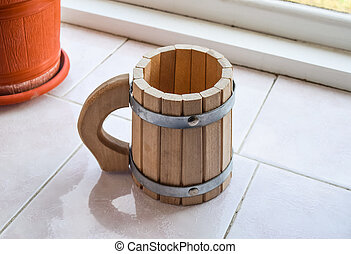 Decorative cup shaped drums. Wooden mug of beer