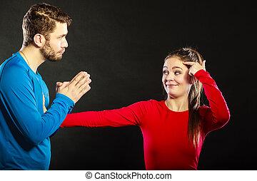 Regretful man husband apologizing woman wife. - Husband...