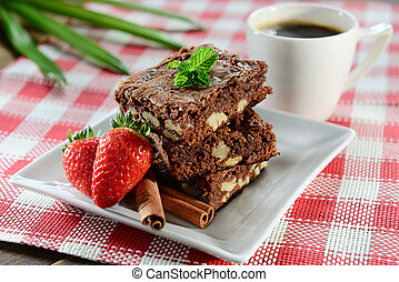 Brownie pyramid on squared plate
