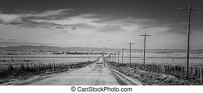 A mile to the Village - A dirt road to a small town in...
