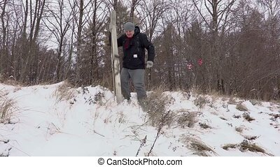 Man with pair of ski falling on slope