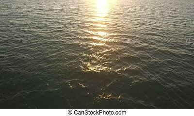 clear ocean water sunset reflection - Nice calm surface of...