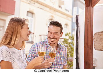 Happily laughing couple drinking some beers - Cute couple...