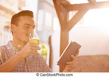 Short haired man with beer and touchpad - Handsome short...