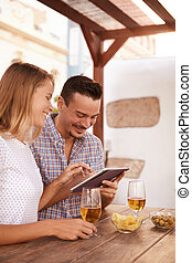 Happy millennial couple sharing a touchpad - Happy millenial...