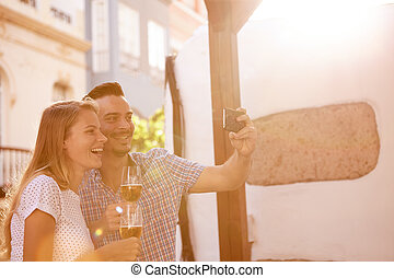 Beer dinking couple posing for selfie - Happy couple posing...