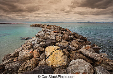 The breakwater at San Pedro Beach in Betlem, Mallorca,...