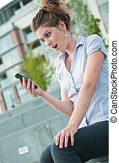 What has happened - woman with mobile phone