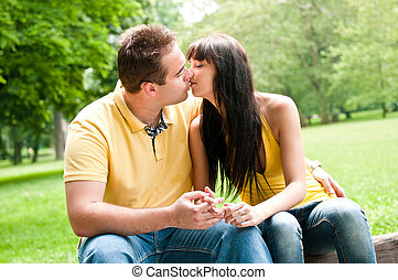 Intimate moments - couple kissing outdoors - Young couple in...