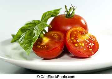 Two tomatoes in a white plate