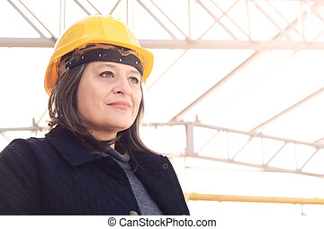 Female architect at a construction site. - Close up of a...