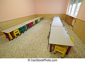 lunchroom nursery with tables and small chairs for children