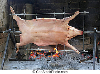 pig while it is cooked in spit of restaurant