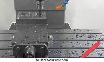CNC milling machine working - CNC automated cutting machine...